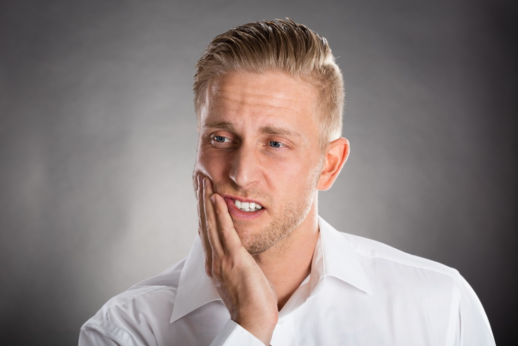 Man experiencing toothache