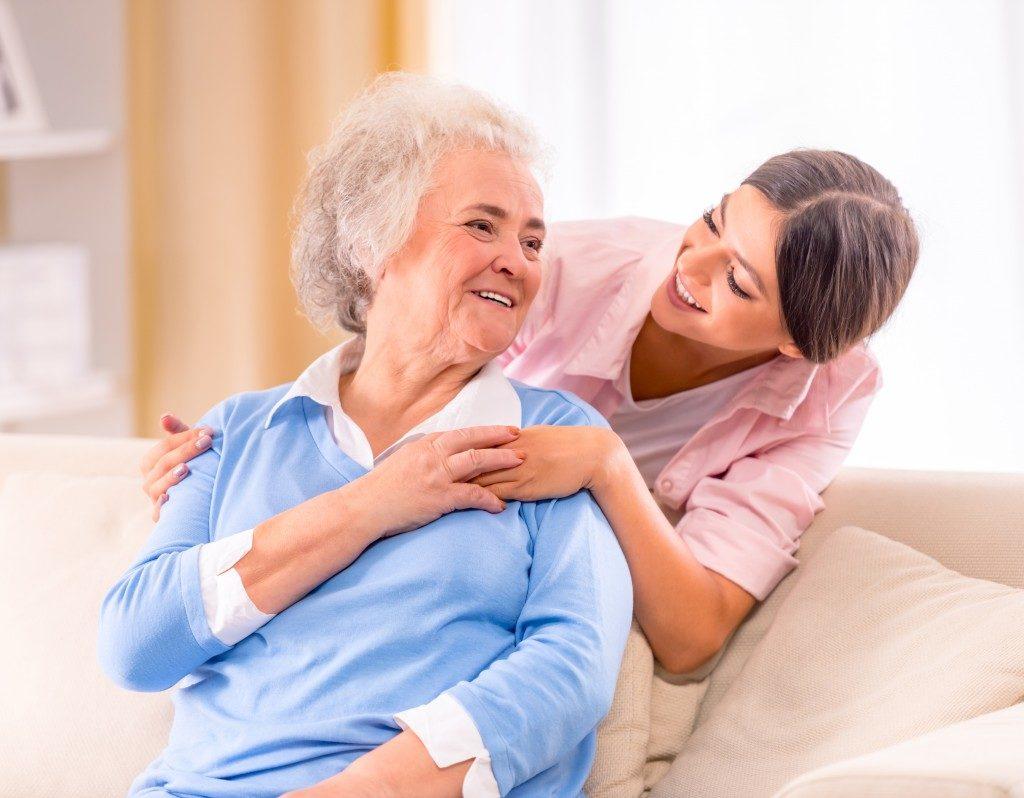nurse taking care of an elderly