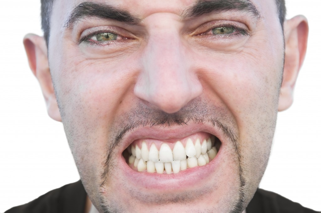man grinding teeth in anger