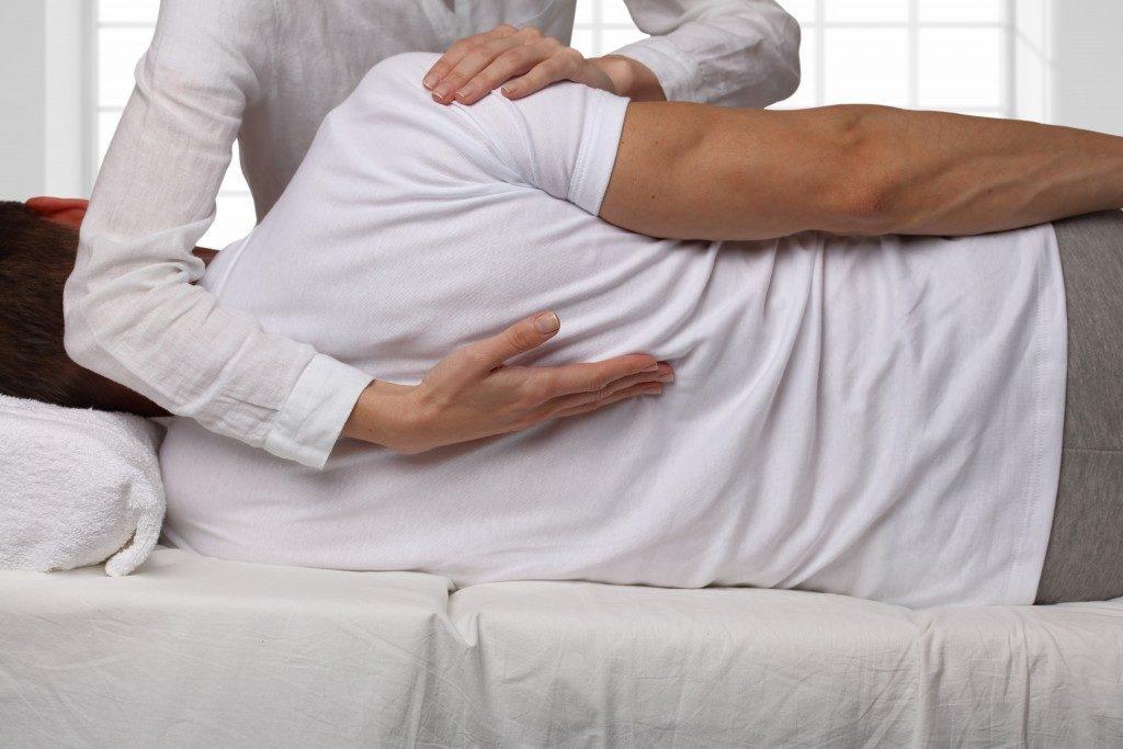 Man having chiropractic back adjustment
