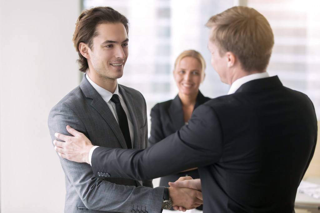 Shaking hands with legal representative
