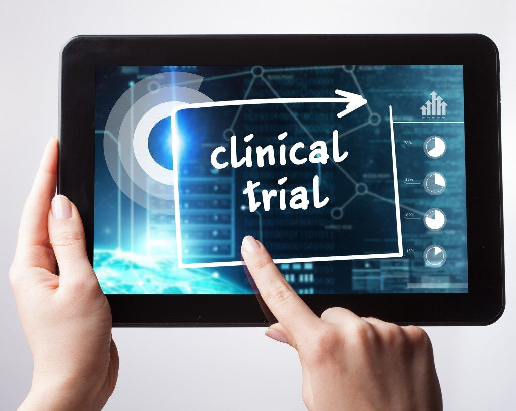tablet with clinical trial word being pushed
