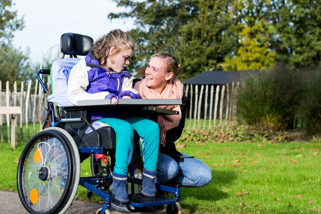 disabled person talking to a girl