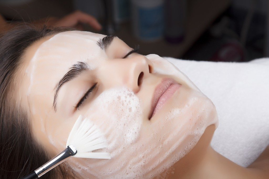 Woman having a facial cleanse