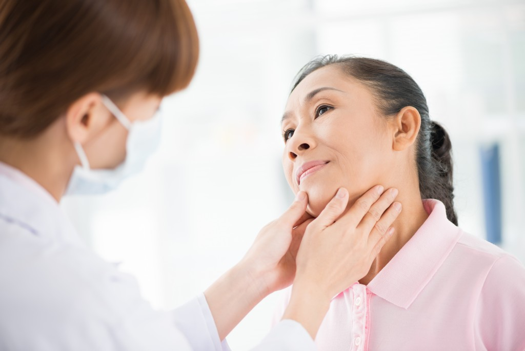 Woman getting her thyroid checked