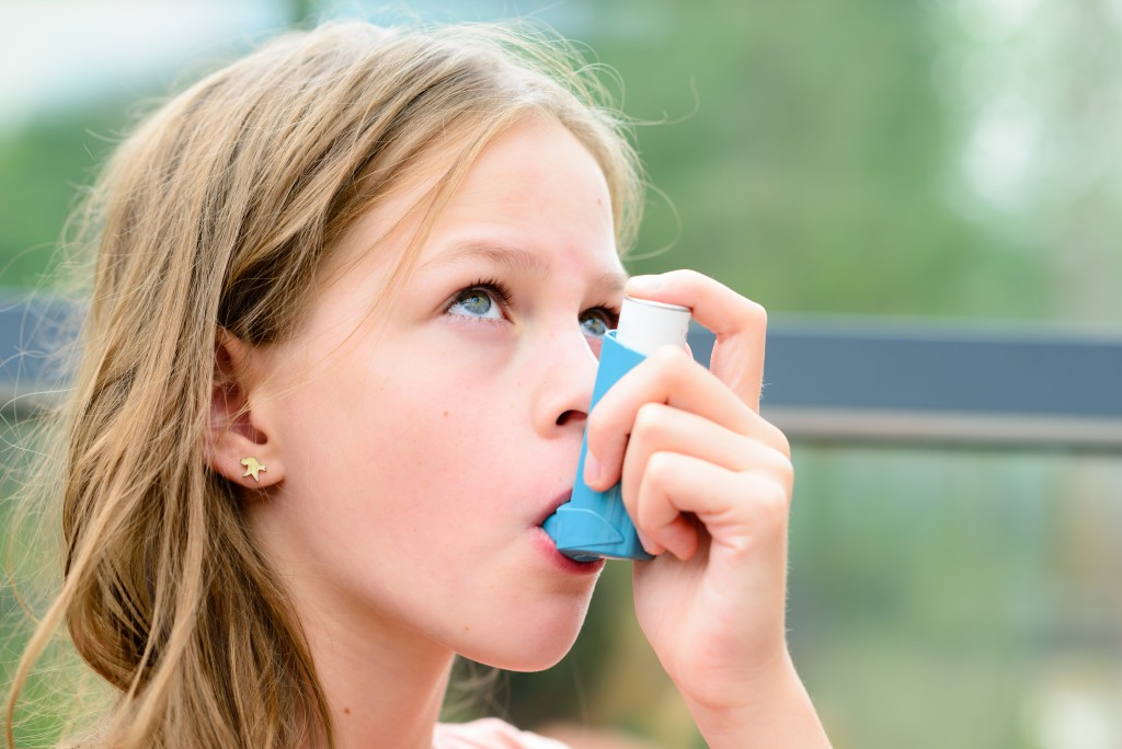 a child using her inhaler