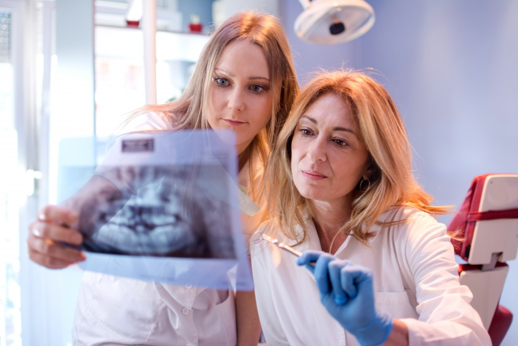 Dentists looking at an x-ray of teeth