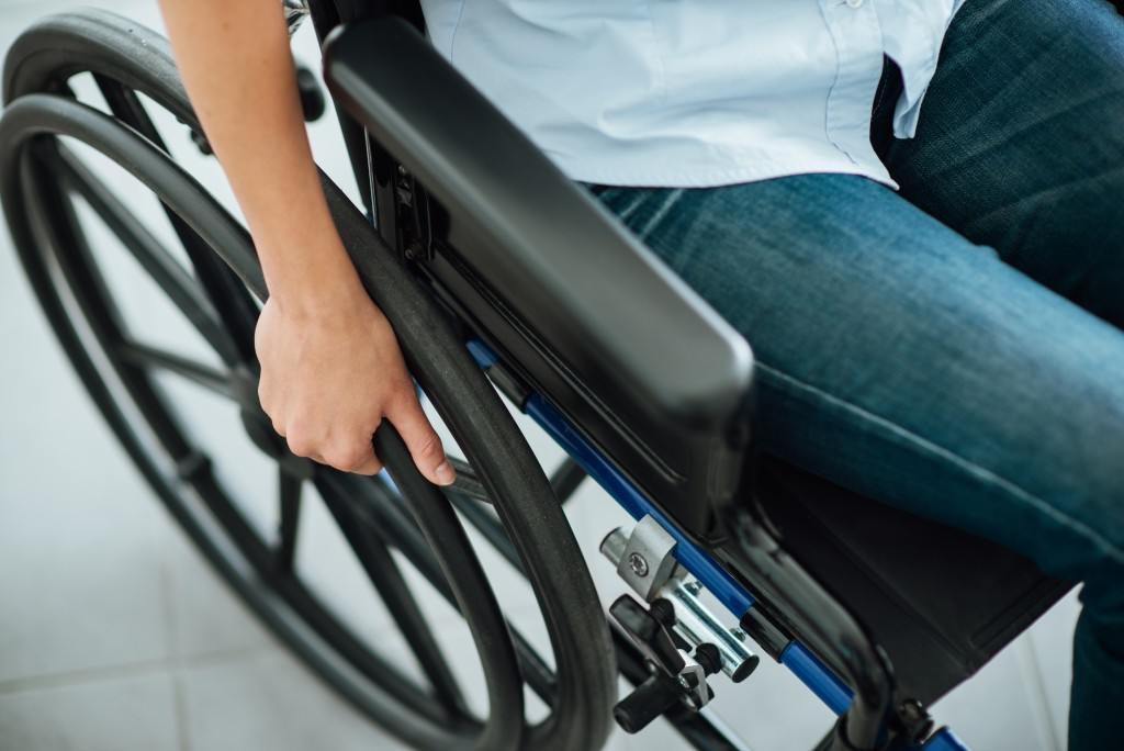 Close up of person sitting on wheelchair