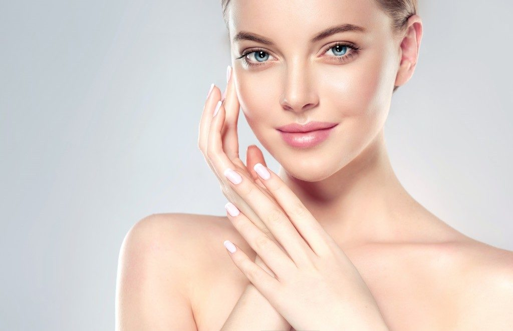 young woman with healthy glowing skin