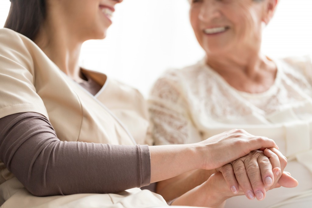 Senior woman with her nurse