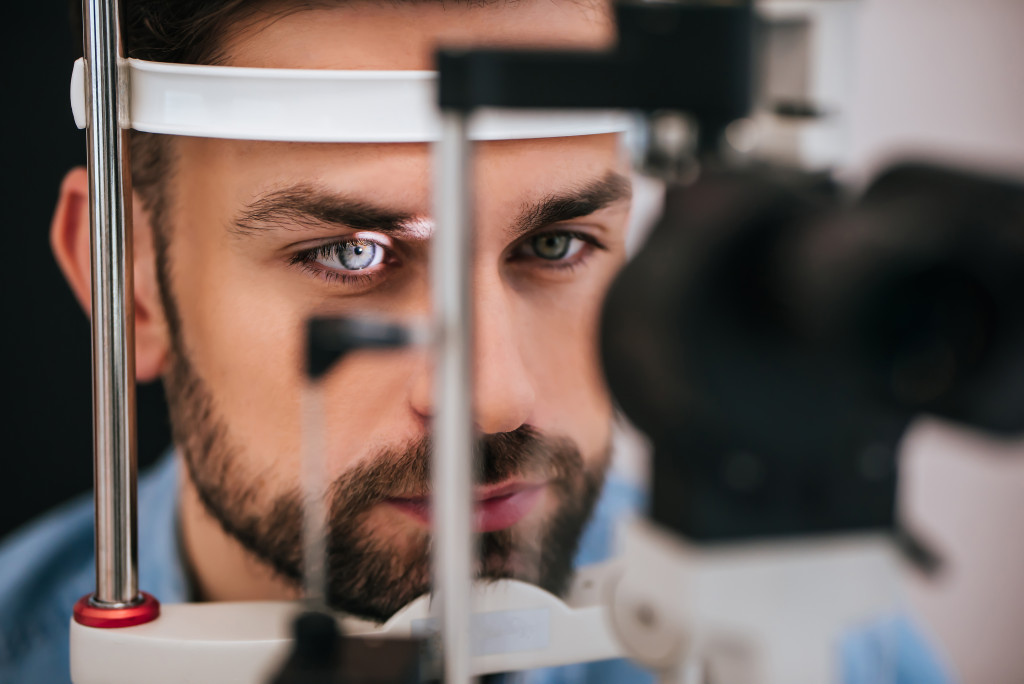 man getting eye check up