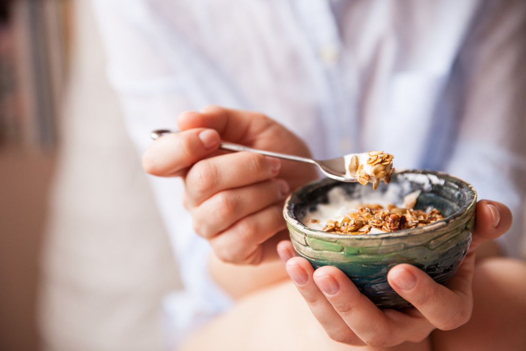 person eating yogurt
